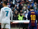 Real Madrid's Cristiano Ronaldo and Barcelona's Lionel Messi leave the pitch at halftime in 2017