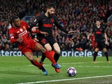 Liverpool's Georginio Wijnaldum in action with Atletico Madrid's Felipe in the Champions League on March 11, 2020