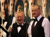 Dennis Taylor and Steve Davis (R) are presented to the audience during the afternoon session in April 2010