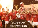 Wales players celebrate completing the Grand Slam and winning the Triple Crown and Six Nations Championship with the trophies