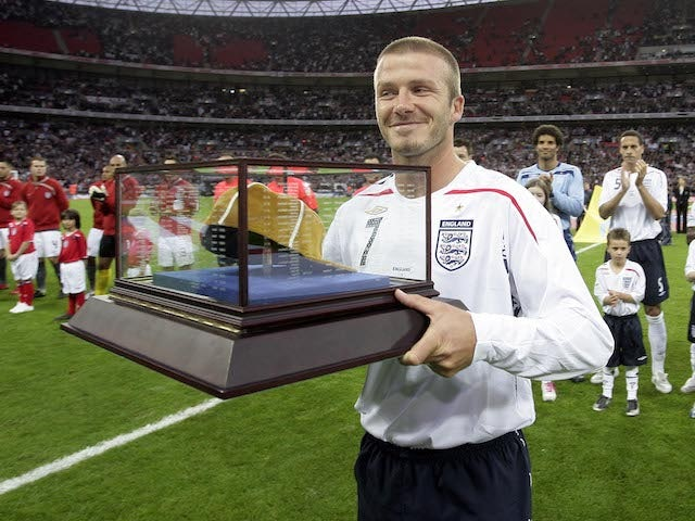 David Beckham celebrates winning his 100th cap for England in 2008