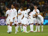 England players look dejected after losing a penalty shootout to Italy at Euro 2012