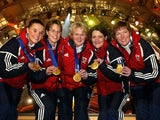 Olympic womens curling champions Great Britain, Fiona MacDonald (L), Janice Rankin (2L), Debbie Knox (2R), Rhona Martin (3L) and Margaret Morton pose during medal ceremonies at the Salt Lake 2002 Winter Olympic Games February 21, 2002