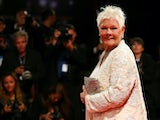 Dame Judi Dench clocks the camera in September 2017