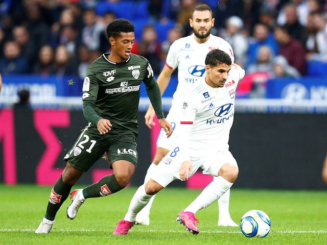 Lyon's Houssem Aouar in action with Dijon's Mounir Chouiar in October 2019