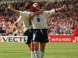 Paul Gascoigne celebrates with Teddy Sheringham after scoring for England against Scotland at Euro 96