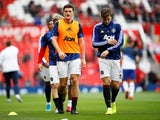 Manchester United's Harry Maguire and Victor Lindelof during the warm up before the match in August 2019
