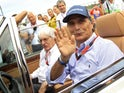 Former Formula One driver Nelson Piquet of Brazil (R) and Formula One supremo Bernie Ecclestone arrive at the drivers parade before the Hungarian F1 Grand Prix at the Hungaroring circuit, near Budapest, Hungary July 26, 2015