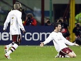 Arsenal's Cesc Fabregas (R) celebrates with his team mate Bacary Sagna after scoring against AC Milan during their Champions League first knockout round, second leg soccer match at the San Siro stadium in Milan March 4, 2008