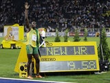 Usain Bolt of Jamaica celebrates winning the men's 100 meters final during the world athletics championships at the Olympic stadium in Berlin, August 16, 2009. Bolt set a world record of 9.58 seconds in the race