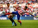 Atletico Madrid's Angel Correa in action with Sevilla's Diego Carlos in La Liga on March 7, 2020