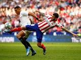 Atletico Madrid's Angel Correa in action with Sevilla's Diego Carlos in La Liga on March 7, 2020