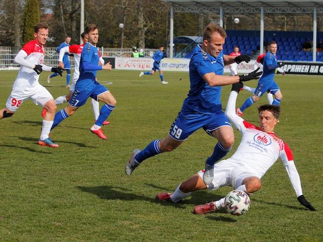 Belarusian football sees Slutsk's Roman Krivulkin in action with Slavia-Mozyr's Igor Costrov in March 2020