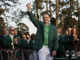 Danny Willett celebrates in the green jacket after winning the 2016 The Masters golf tournament at Augusta National Golf Club