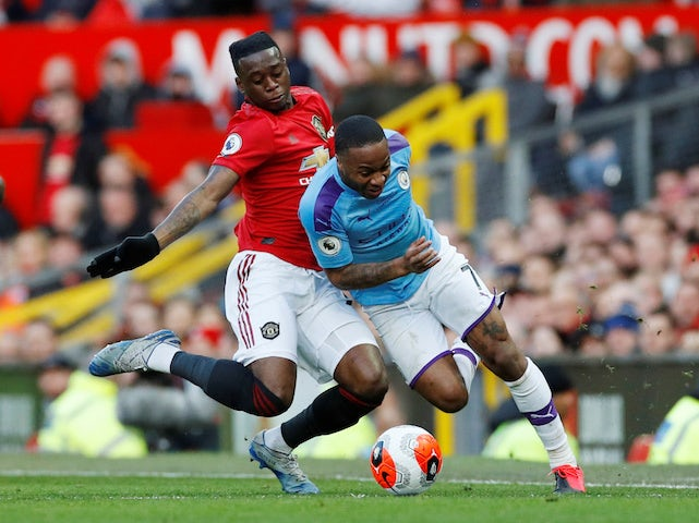 Manchester City's Raheem Sterling in action with Manchester United's Aaron Wan-Bissaka on March 8, 2020