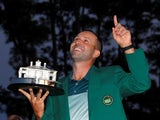 Sergio Garcia of Spain points to the sky as he holds the Masters trophy after winning the 2017 Masters golf tournament at Augusta National Golf Club in Augusta, Georgia, U.S., April 9, 2017
