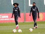 Manchester United's Tahith Chong and Timothy Fosu-Mensah pictured in March 2020