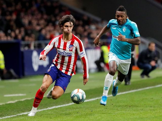 Atletico Madrid's Joao Felix in action with Osasuna's Pervis Estupinan in December 2019