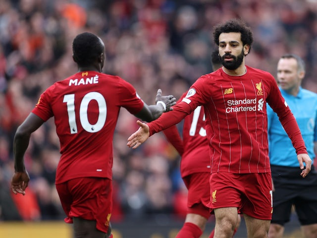 Liverpool's Mohamed Salah and Sadio Mane in action in March 2020