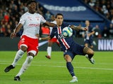 Paris Saint-Germain's Angel Di Maria in action with Reims defender Axel Disasi in September 2019
