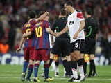 Barcelona's Lionel Messi shakes hands with Manchester United's Rio Ferdinand after winning the Champions League final