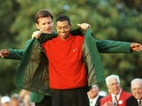 Tiger Woods gets the green jacket after winning the Masters in 1997
