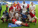 Arsenal players celebrate winning the title at White Hart Lane in 2003-04