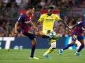 Barcelona's Sergio Busquets in action with Villarreal's Andre-Frank Zambo Anguissa in September 2019