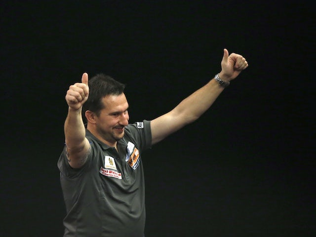 Darts roundup: Clayton throws nine-darter in Premier League victory