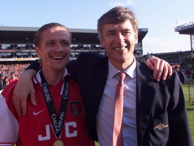 Arsene Wenger and Emmanuel Petit pictured in May 1998