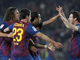 Isaac Cuenca celebrating with Barcelona royalty in 2012.