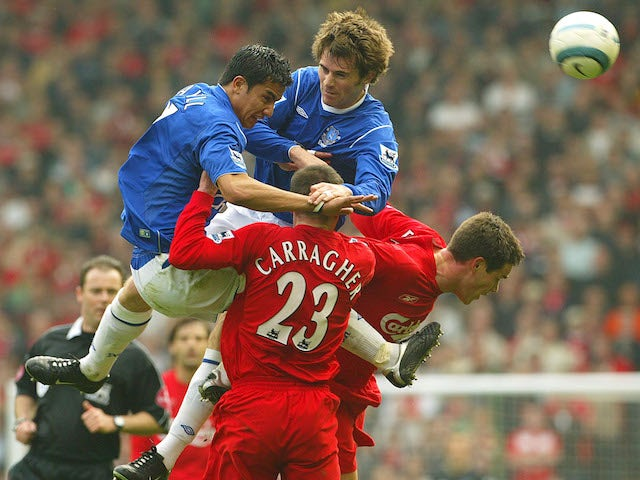 Liverpool and Everton players compete for the ball in a 2005 Premier League match
