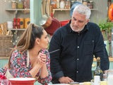 Paul Hollywood inspects Kelly Brook's efforts on the Great British Bake Off