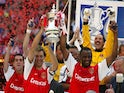 Arsenal lift the FA Cup at the Millennium Stadium on May 4, 2002
