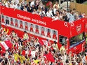 Arsenal celebrating their 2003-04 Premier League title success with their supporters