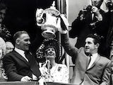 Tottenham Hotspur manager lifts the FA Cup with Danny Blanchflower in 1961