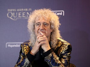 "Brian May reveals he suffered ""a small heart attack"""