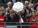 DavidMoyes lifts the Community Shield with Man Utd in 2013