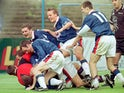 Jimmy Glass is mobbed by Carlisle teammates after his famous goal against Plymouth in 1999