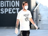 Barcelona's Lionel Messi turns up for training in a facemask on Wednesday, May 6