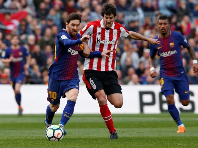 Athletic Bilbao's Mikel San Jose battles Lionel Messi for possession in 2018