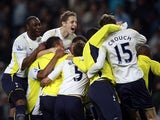 Tottenham players celebrate qualifying for the Champions League in 2010