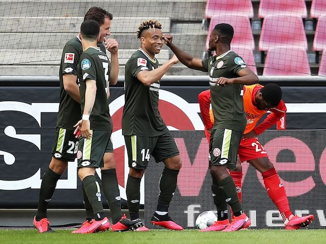 Mainz players celebrate equalising against Koln on May 17, 2020