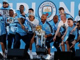 Manchester City's player celebrate with the Premier League trophy in May 2018