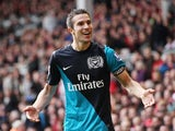 Robin van Persie celebrates scoring for Arsenal in 2012