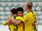 Borussia Dortmund players celebrate scoring against Wolfsburg on May 23, 2020