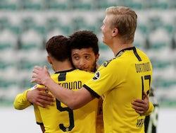 Borussia Dortmund players celebrate scoring against Wolfsburg on May 23, 2020