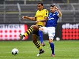 Borussia Dortmund's Manuel Akanji in action with Schalke's Daniel Caligiuri in the Bundesliga on May 16, 2020