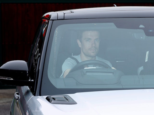 Liverpool captain Jordan Henderson drives into training on May 19, 2020
