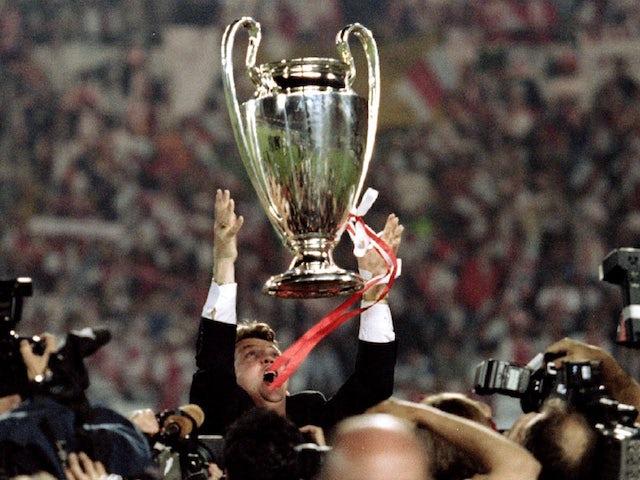 Louis van Gaal celebrates with the 1995 Champions League trophy after Ajax's success
